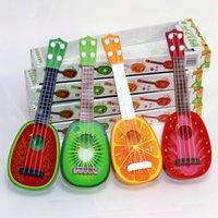 brinquedos de bebê cor música venda por atacado-Baby Music Sound Toys suzakoo Dos desenhos animados fruta guitarra instrumento musical jogo de brinquedo um pcs cor aleatória