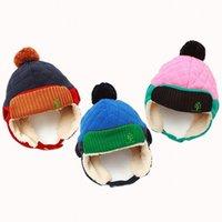 niños azules orejas de sombrero al por mayor-Sombrero de invierno de calidad para niños con orejeras de piel para bebés, niñas y niños gruesos y gorro de nieve con pom pom para niños, sombrero azul rosado con cubierta de oreja J190528