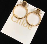 anillo doble simple al por mayor-Joyas para mujer 2019 pendientes de anillo de perla doble personalidad vanguardista moda simple