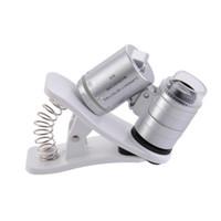 microscopio de luz uv al por mayor-60X Clip-On microscopio de lupa para teléfono con luces LED / UV para Universal SmartPhones iPhone Samsung HTC Magnifier 35pcs