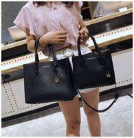 yumuşak deri siyah çanta toptan satış-Ünlü Tasarımcı Marka Kadın Deri Çanta Büyük Kapasiteli Shopper Çanta Yüksek Kalite 2018 Yeni Kilit Siyah Casual Tote Çanta Yumuşak