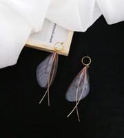 schöne elegante anhänger großhandel-Super Fairy Elegant Wind Elegant Sen Nur schöne zarte Flügel ein Wort gekreuzt lange weibliche Ohrringe Anhänger Retro