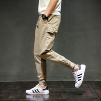 männer booten gelbe farbe großhandel-Mode Streetwear Jugend Herren Jeans Jogger Hosen Gelb Farbe Boot Cut Slim Fit Bein Marke Knöchel Gebänderte Hosen Gebundene Jeans Männer