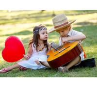mini brinquedo de guitarra venda por atacado-Crianças Bebê Mini Sabedoria Desenvolvimento Simulação Ukulele Música Guitarra Toy New Kids Guitar Music Toy