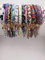 pulsera de borla 14k al por mayor-32 colores PU cuero de la pulsera colgante BraceletBangle Llavero Redondo gota de aceite para las mujeres de la borla de la muchacha Correa para la muñeca