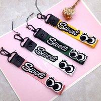 cordons doux achat en gros de-Téléphone portable poignet suspendu corde Sweet Eyes Creative téléphone Staps Téléphone Lanière Badge Lanière Expédition rapide