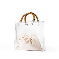 ingrosso borse griffate bambù maniglie-Summer Fashion Trasparente Bamboo Top Tote Bag Trasparente Borsa da donna e borsa da spiaggia Marca Designer Lady Pvc Jelly Hand Bag