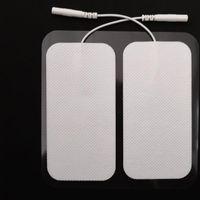 almohadillas de diez unidades al por mayor-ENET electrodos de desfibrilación Unidad 2 * 4 pulgadas rectangular electrodos para TENS masaje masajeador ccsme Dispositivo con Larga Duración Gel fiable