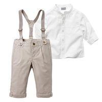 conjuntos de trajes de niño blanco al por mayor-Mezcla de algodón Boy Baby Kid 2 piezas Camiseta blanca Top + Pantalones babero Conjunto general Traje de tela 2-6Y Baby Boy