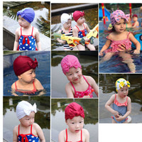 Wholesale fashion design baby hat resale online - 0 T New design children swimming cap solid color elastic bow knot bathing cap fashion cotton baby girl accessories