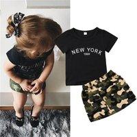 pantalones cortos de camuflaje de las niñas al por mayor-Newborn Kid Baby Girl Ropa Cuello Redondo Manga Corta Carta Imprimir Top Camuflaje Botón Faldas de Bolsillo 2pc Niño Algodón Outfit
