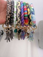 pulseiras chaveiro venda por atacado-Favor livre DHL Pulseira de couro Chaveiro de PU Wrist Chaveiro de borla pendente Pulseiras Sports Keychain pulseiras Rodada Anéis partido