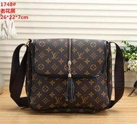 kadın çantası moda peş peşe el çantaları toptan satış-Çanta tasarımcısı moda omuz çantaları erkek kadın PU deri çanta bayanlar püskül kılıf kadın mektuplar logo Crossbody Messenger çanta q1
