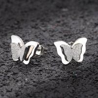 aretes de oro para cartilago al por mayor-Nuevos pendientes de mariposa Pendientes de botón de acero inoxidable color oro rosa para mujer Pendientes de oreja de cartílago de mariposa esmerilado