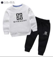 trajes más vendidos al por mayor-2019 boy Kids Sets Kids Baby 2-9 años vende mejor nuevo otoño boy camisa suéter hoodle chaqueta boy deportes traje con capucha 3 tamaños de color