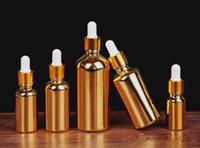 Wholesale golden bottle cosmetic online - 2019 hot selling ml glass gold dropper bottle with gold cap essential oil perfume golden cosmetic glass dropper bottle