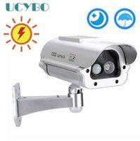 sensores cctv venda por atacado-Movido a energia solar ao ar livre CCTV Home Security chamariz Falso Manequim Câmera Cam Com Piscando Luzes LED Infravermelho + Detecção do Sensor Humano