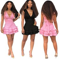 mini pembe plaj elbisesi toptan satış-Papyon Up Backless Yaz Mini Elbise Kadınlar Siyah Derin V Boyun Ruffles Eklenmiş Wrap Elbise Seksi Pembe Kolsuz Plaj Parti Elbise NZK-1842
