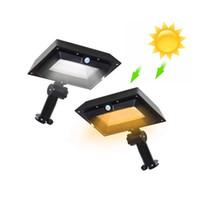 lampadaires achat en gros de-2019 nouvelle lampe murale d'extérieur solaire de haute qualité transfrontalière blanc noir Spot Light lamp olars lumière 6W P67 projecteur jardin extérieur lumière de rue