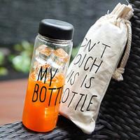 los titulares de botellas de jugo al por mayor-Sport Fruit Juice Water Cup Holder Bolsa de viaje portátil Botella de almacenamiento con cordón