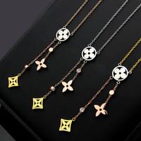 quaste großhandel-V-Brief Ausschnitt vierblättrige Blume Quaste Farbe Halskette Damen dreifarbige vierblättrige Klee-Halskette