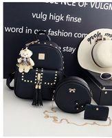 amerikan stili poşetler toptan satış-Hakka Moda Sırt Çantası Bayanlar Womem Zincir Omuz çantaları 3 adet Set Kart Tutucu Çiviler Perçin Çiçek Püskül Ayı Acc. Kore Japonya Stili Amerikan