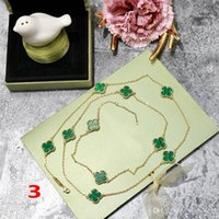 pendentif trèfle en laiton achat en gros de-Mode trèfle à quatre feuilles en laiton bleu d'or Dix fleurs pendentif collier pour les femmes Lovers Day cadeau designer classique bijoux de marque pour femmes