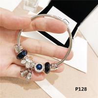 armbänder katzenaugen großhandel-Neue Pan Ocean Herz Cat-Eye Traumfänger Armband weibliche Glocke Zubehör Anhänger Hand Armband weiblich