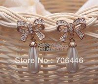ingrosso orecchini di goccia del rhinestone di tono dell'oro-Orecchini Tone Rose Gold trasparente con strass di cristallo di goccia dell'acqua perla crema e disegno dell'arco Orecchino