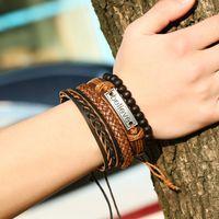 pu diy armbänder großhandel-Armbänder für Männer Punk Armband Perlen Stränge Vier-Stück-Anzug Mode glauben Rindsleder Legierung PU Weave DIY Lederarmband und Seil elastisch