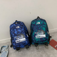Wholesale tablet double online – Supre Luxury Designer Backpack Sup The North Joint Face Camouflage Backpacks Brand Boy Girl Double Shoulder Bag Schoolbags Handbags B80701