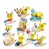 karikatür plaj oyuncakları toptan satış-10pcs / lot En çok satan çizgi film hayvanlar oyuncak Dedektif Pikachu pvc Plaj Pokemons bebek oyuncakları mefruşat ürünleri lol iyi Hediyeler dekorasyon
