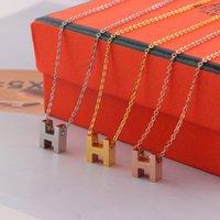 ingrosso pendente di titanio della collana di sport-Classico stile lettera H Ciondolo paio Collana in acciaio al titanio Marca Uomo Donna Gioielli Moda Titanio Sport Accessori