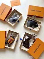 bolsas de regalo de león al por mayor-2019 nuevo llavero lindo animal ratón cerdo león conejo cuero marca diseño llavero bolsa joyería coche llavero regalo de cumpleaños con caja original