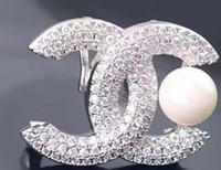 pasadores bufanda de china al por mayor-Broche de diamantes de imitación famoso diseñador traje de solapa Pin para mujeres joyas accesorios con envío rápido 2012