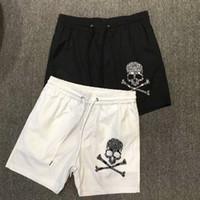 белые пляжные шорты оптовых-Mens Summer Designer Shorts Casual Sports Pants Summer Quick Drying Mens Beach Pants Black and White Asian Size M-3XL