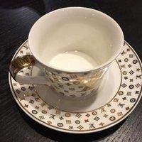 tazas de café de cerámica de estilo europeo al por mayor-Estilo Europeo Catering Bone China Copa Multi-estilo simple plato de cerámica taza de café con patrón Conjunto con la cuchara