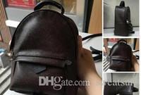 bolsa estilo europa venda por atacado-TOP PU alta qualidade PU Europa saco dos homens Famosos designers bolsas mochila de lona saco de escola das mulheres F1 Mochila Estilo mochilas marcas #