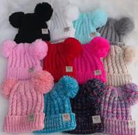 gorritas tejidas blancas al por mayor-2019 sombreros de diseño para niños gorras sombreros de invierno para bebés sombreros de punto para niños al por mayor sombrero de pompones gorros de ganchillo de lana hechos a mano niñas niños gorros