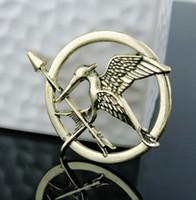 juegos de hambre mockingjay broche pin al por mayor-3 colores juegos del hambre broches Inspirado Sinsajo y la flecha de la película Hunger Games aves broche pernos Niños Mejor L582 regalo