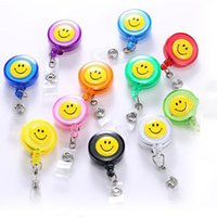 Wholesale smile badge holder resale online - Fashion Retractable Reel Lanyard Smiling Face Card Badge Holder School Office Supplies Metal Clip Easy To Use Free DHL