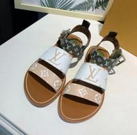 plage unique achat en gros de-Sandales et chaussures de plage à semelles plates intérieures en cuir imprimé pour femmes