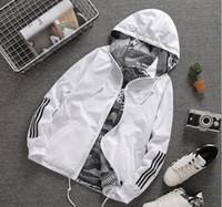 женские двойные пальто оптовых-Весна осень новый человек женская спортивная куртка цветок печати с капюшоном куртки мужская мода тонкий ветровка открытый двусторонняя молния пальто