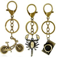 Wholesale copper camera resale online - Trendy Vintage Camera Scorpion Pendant Antique Ring Cartoon Cute Bicycle Key Chain Braided Rope Trinket Gift for Men LL YUN C19011001