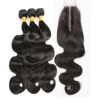 24 inch hair weave al por mayor-El pelo humano brasileño de la onda del cuerpo teje con los paquetes del pelo de la Virgen sin procesar de la parte media del cierre con el cierre del cordón de Kim K 2 * 6 pulgadas