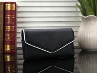 ingrosso porta portafoglio imballaggio foto-Portafogli essenziale di marca delle donne di modo di colore solido lungo foto Titolare della carta Holde pacchetto di carta banchetto partito avversario sacchetto 8 colori