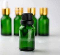 botellas de aceite esencial verde 15ml al por mayor-Venta caliente 15 ml Botellas de aceite esencial de vidrio verde Botellas líquidas de cigarrillos electrónicos vacíos 15 ml Con tapón de rosca de oro negro en existencias