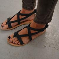 chanclas estilo playa al por mayor-Flip flops sandalias superpuestas zapatos de estilo roma mujeres de fondo plano de verano fresco popular playa al aire libre 26jt f1