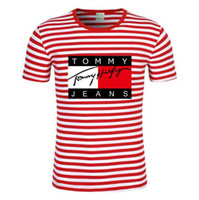 Wholesale graffiti clothing brands online - Summer designer T shirt Casual Women men s short sleeved breathable T shirt graffiti T shirt men s clothing brand Stripe printed T shirt
