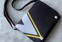 New2018ERT Famous Classic Designer Fashion Men Leather Messenger Bags Cross body Bag School Bookbag Shoulder Bag Briefcase 28CM